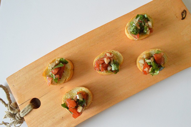 Baguette topped with tomato basil mixture.