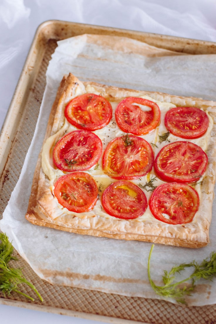 Tomato tart recipe with puff pastry crust.
