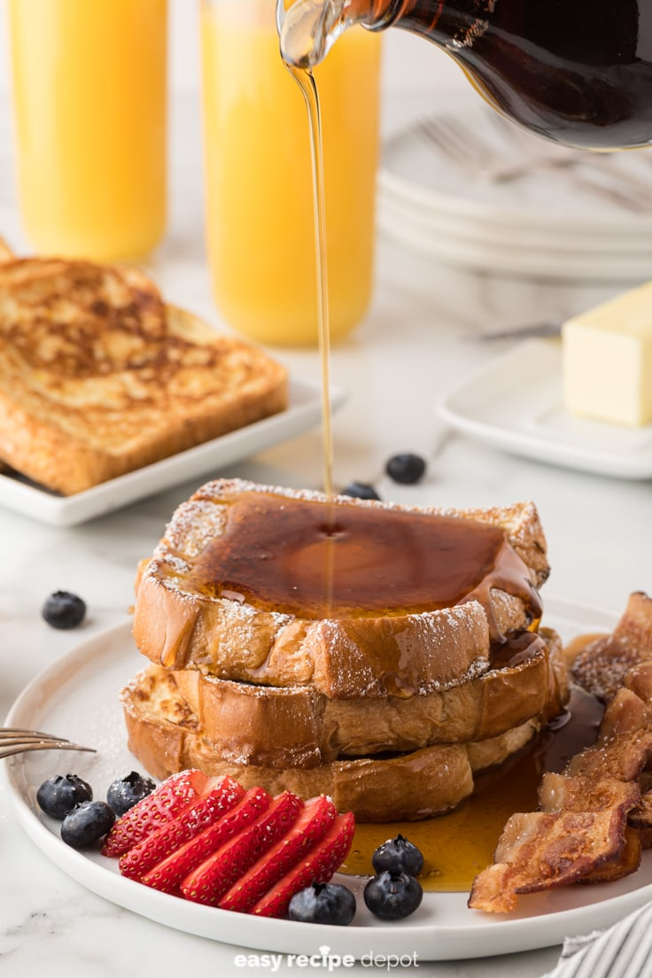 Maple syrup poured over french toast.