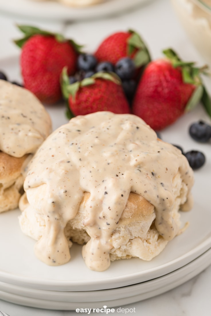 Country style black pepper cream gravy over biscuits.