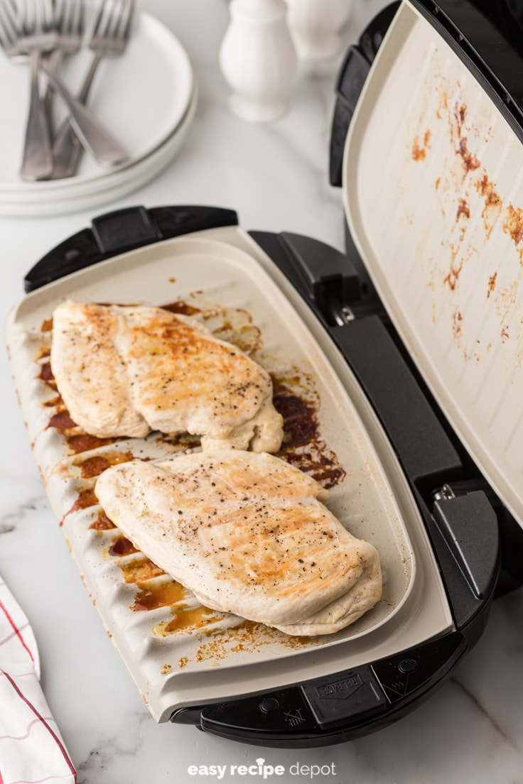 Grilling chicken breasts on a George Foreman grill.