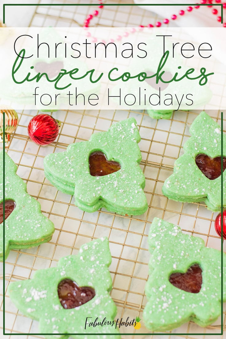 Looking for a holiday cookie to bake this year? These Christmas Tree Linzer Cookies will impress your guests and fill their bellies! So adorable! #holidaylinzercookies