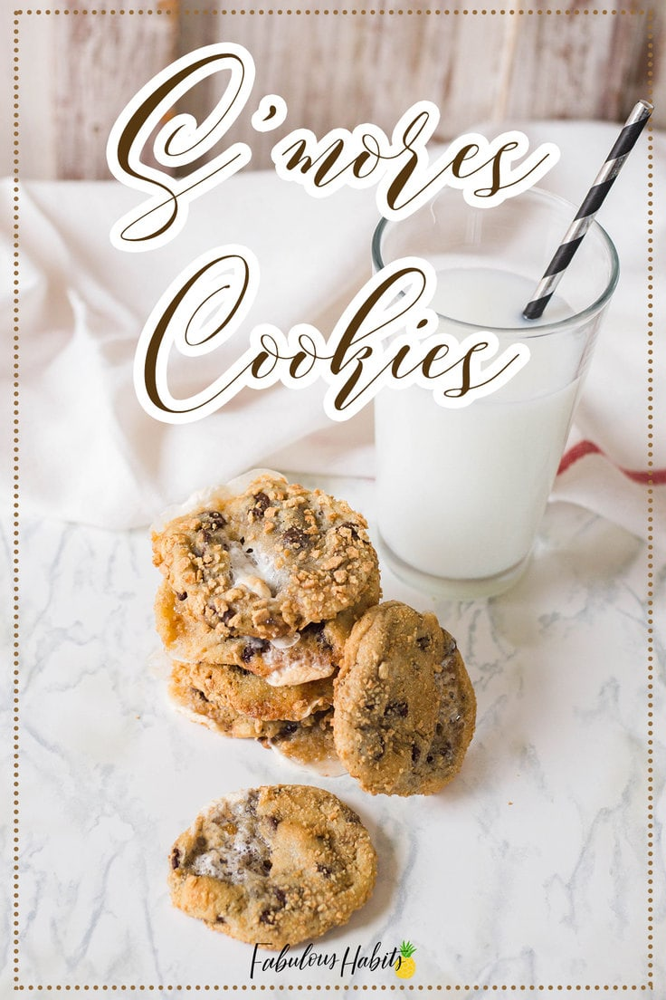 These s'mores cookies are the perfect way to ring in the summer season! Who needs a campfire when you can make these cookies straight in your oven?! #smoreschocolatechipcookies