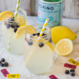 This Sparkling Lemonade with Blueberries is super refreshing on hot summer days. Plus, it's easy to put together - and your guests will think it's 100% homemade (hint: it's not!) #easylemonade