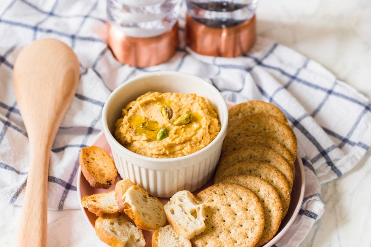 This homemade sweet potato hummus is REALLY delicious - and so easy to make! All it takes is a few ingredients and a food processor and ta-da... hummus is complete!