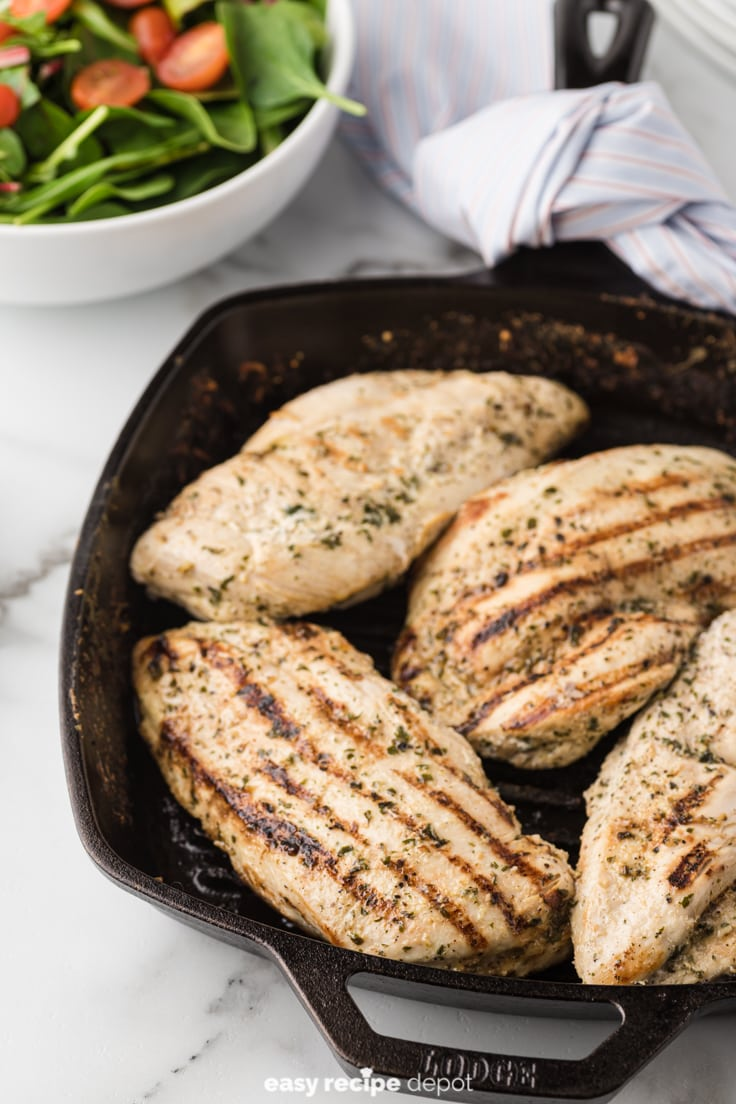 Low-sodium chicken breasts in a cast iron grill pan.