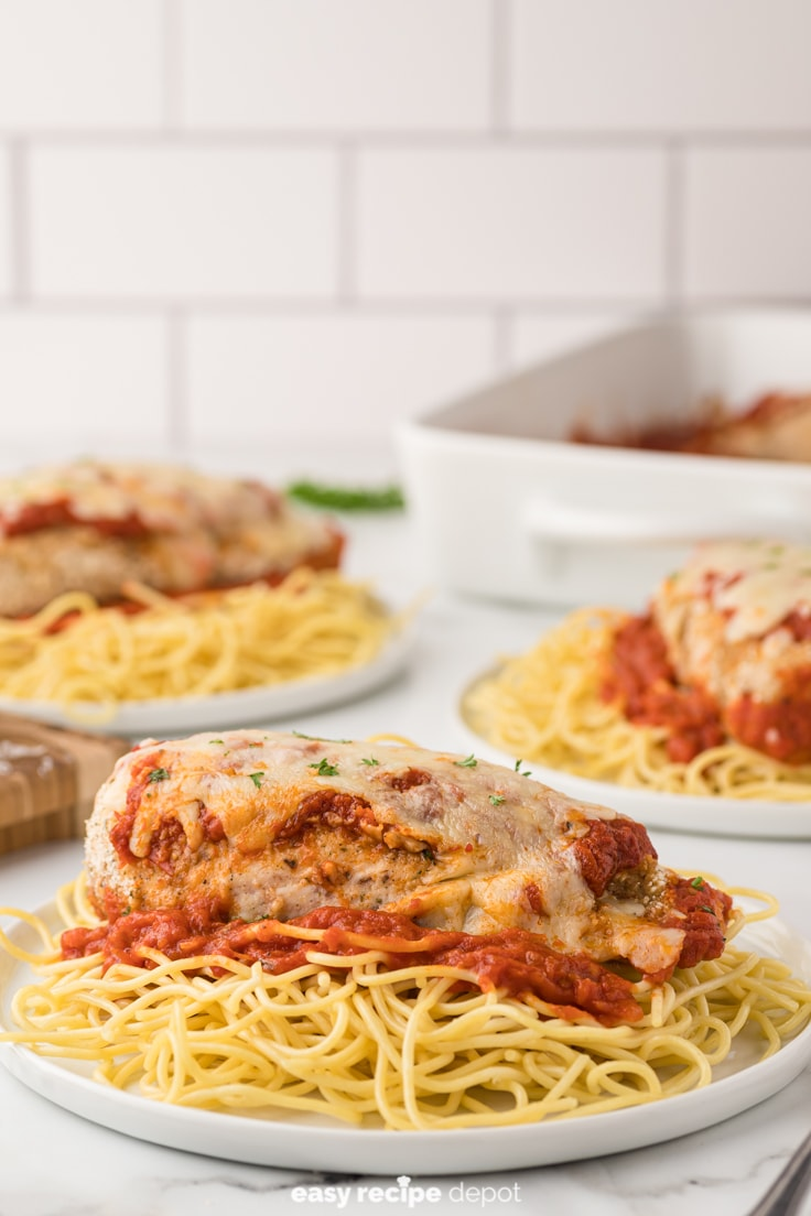 Oven baked chicken parmesan and spaghetti.