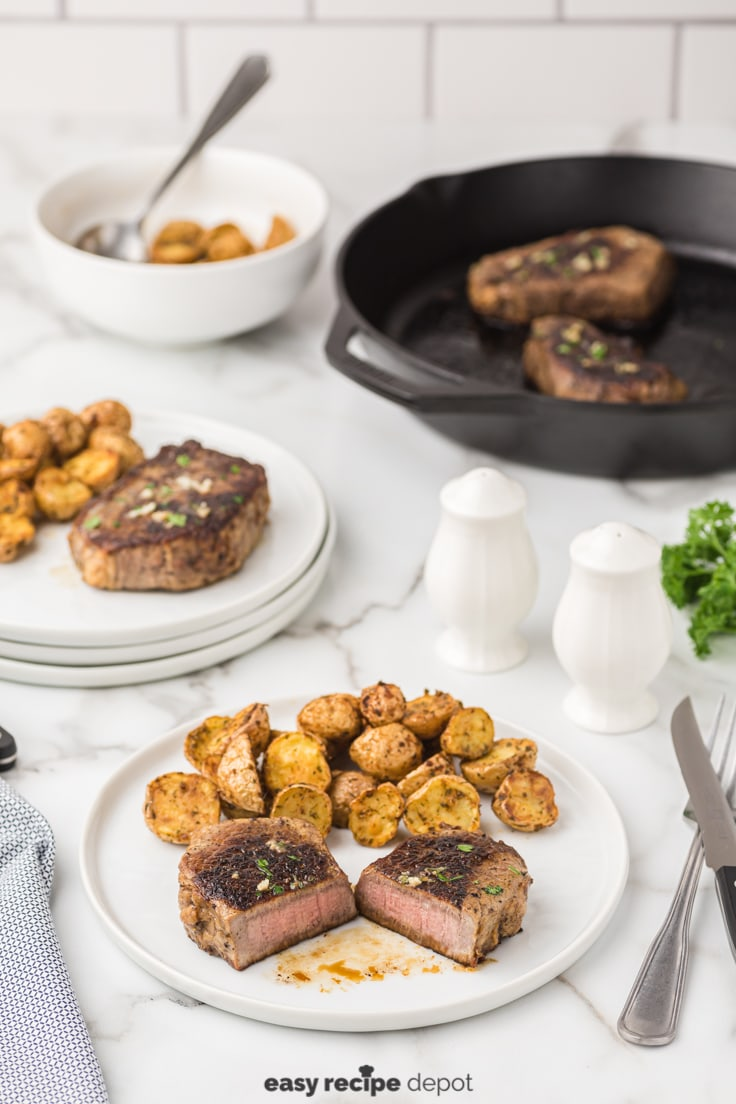 Pan seared steak cut in half showing the inside of the meat.