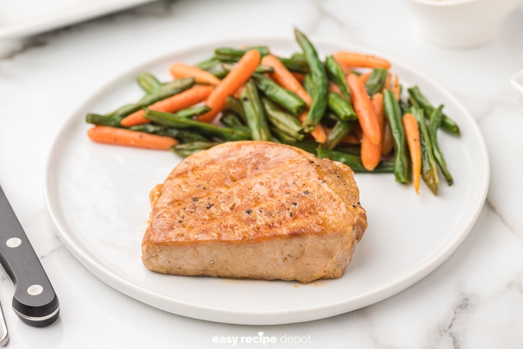 Grilled pork chops with veggies.