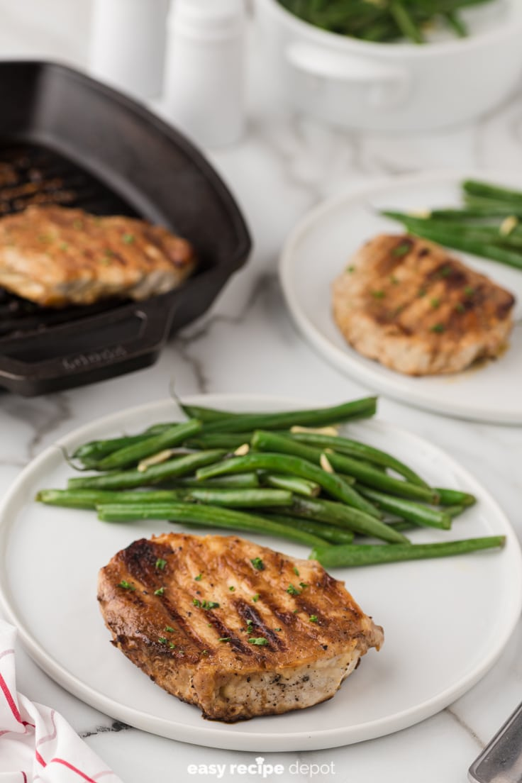 Brown sugar pork chops served with green beans.