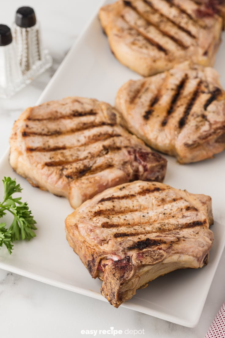 Grilled pork chops with the bone.