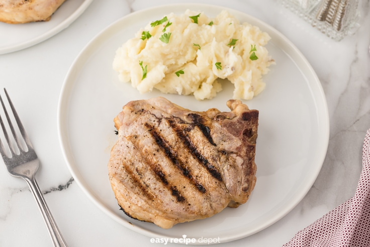 grilled pork chops served with mashed potatoes