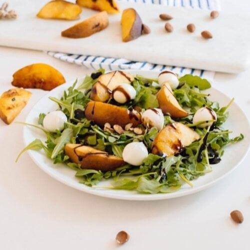 Arugula and grilled peach summer salad recipe.