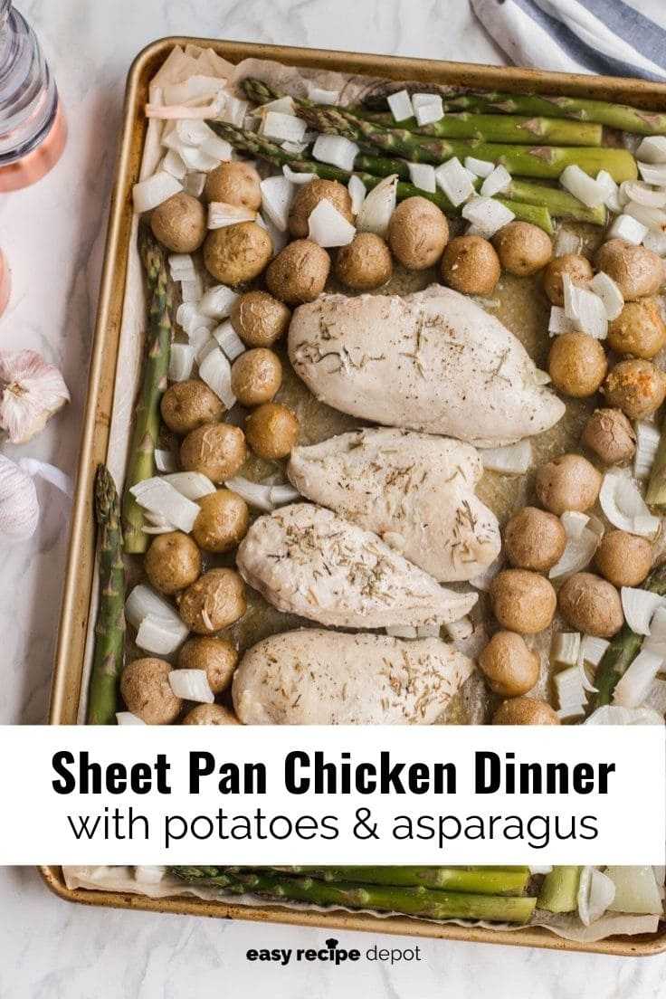 Sheet pan chicken dinner with potatoes and asparagus seasoned with garlic and herbs.